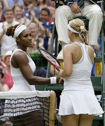 Sabine Lisicki greets Serena Williams at the net after winning their singles match. (AP)