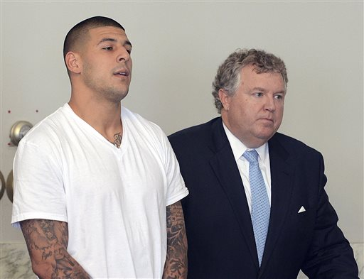 Aaron Hernandez stands with his attorney, Michael Fee, during arraignment in Attleboro District Court. (AP)