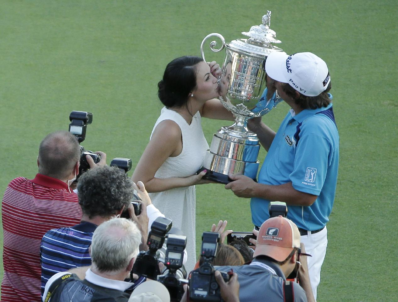 Jason Dufner, right, kisses the Wanamaker Trophy with his wife Amanda. (AP)