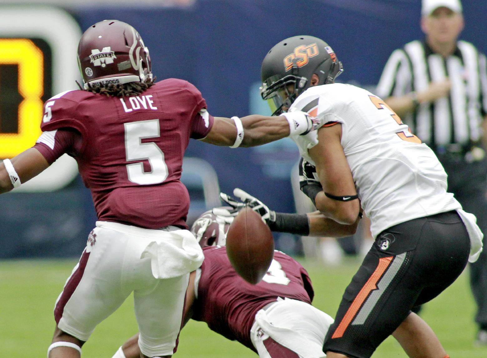 Walsh helps No. 13 Oklahoma State beat Miss. St