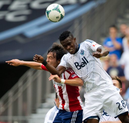 Heinemann lifts Whitecaps to draw with Chivas USA
