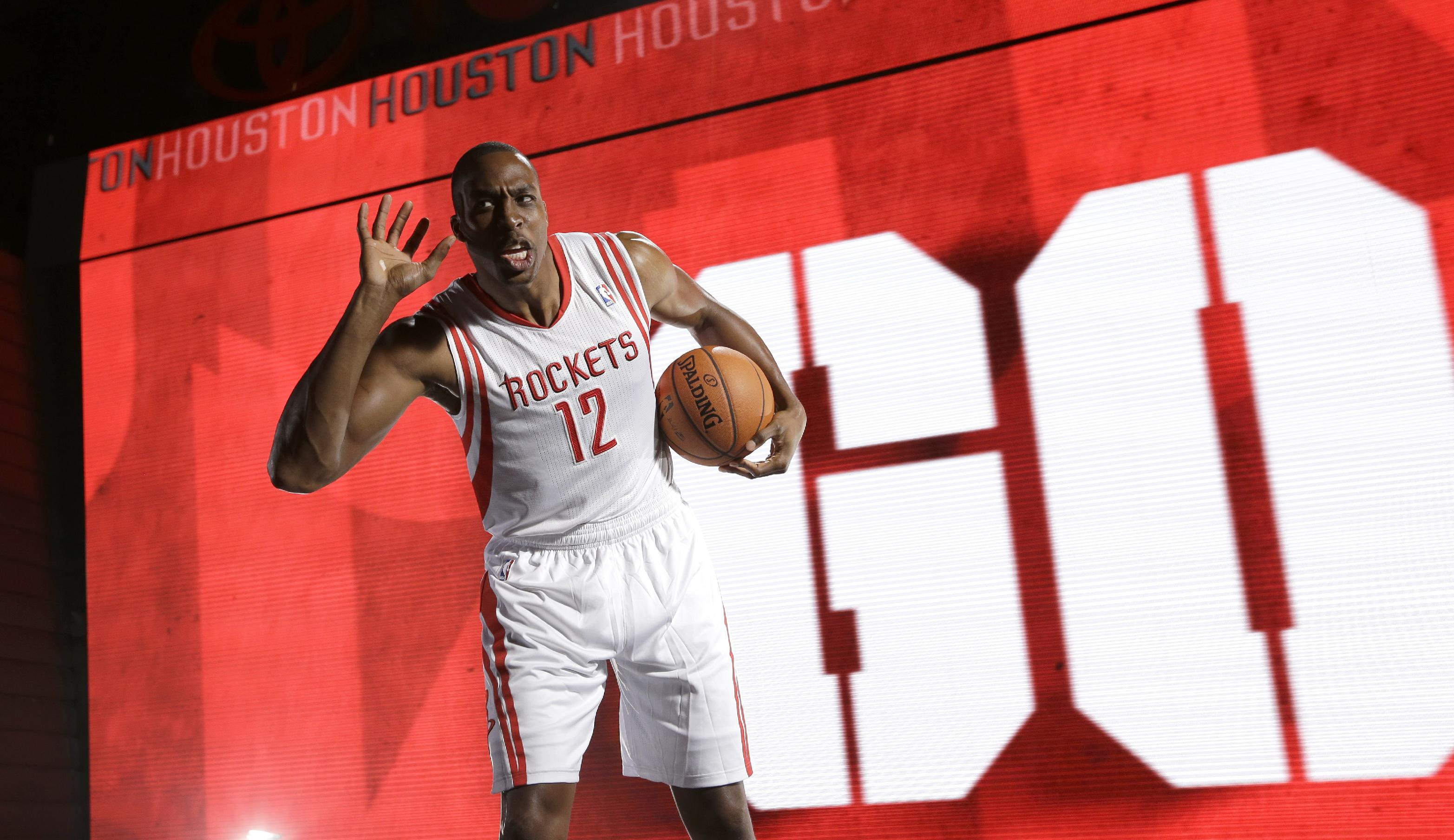 Dwight Howard left the Lakers to chase a title with the Rockets. (AP)