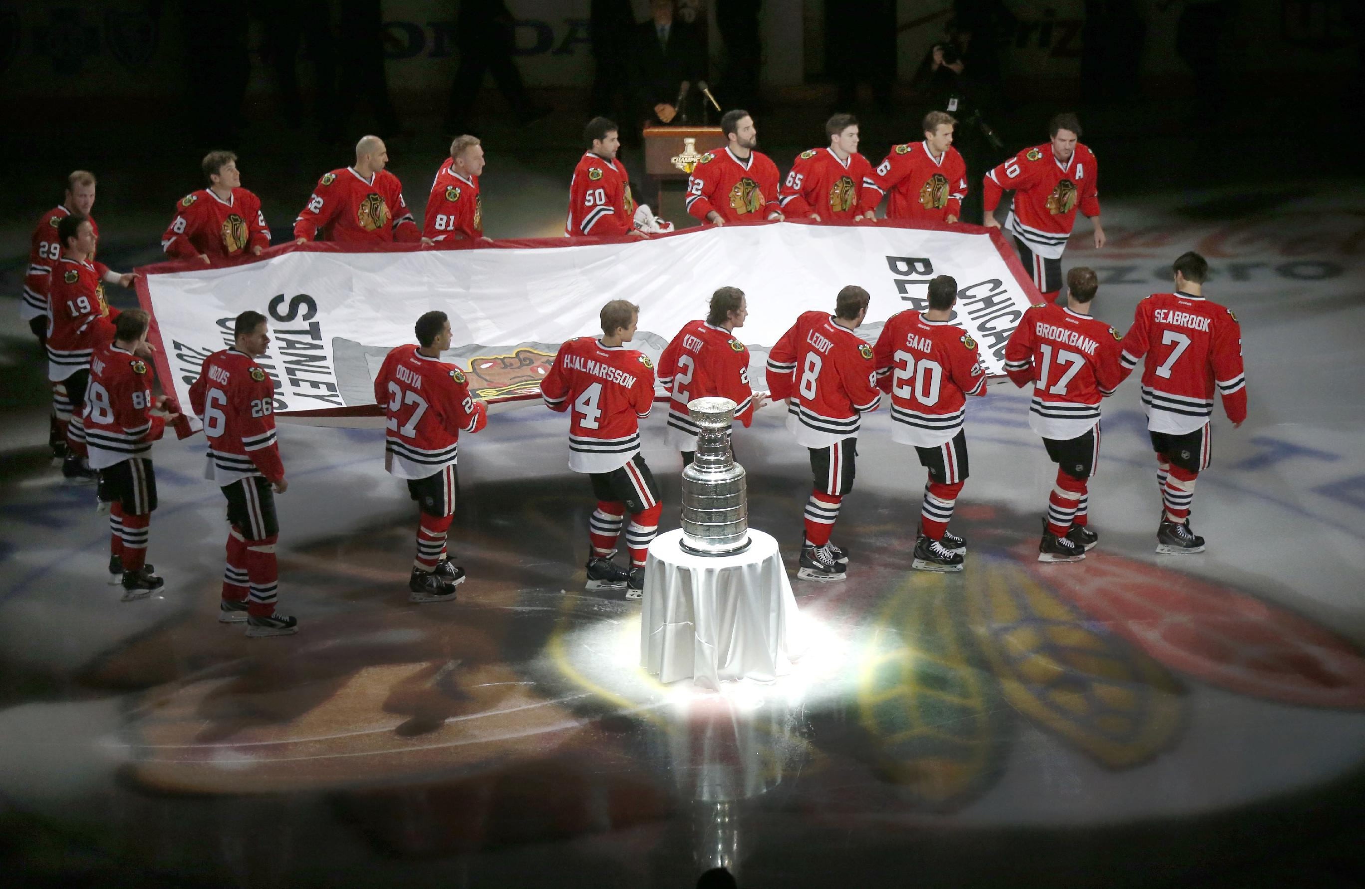 The Blackhawks have raised their Stanley Cup banner and started working on a new one. (AP)