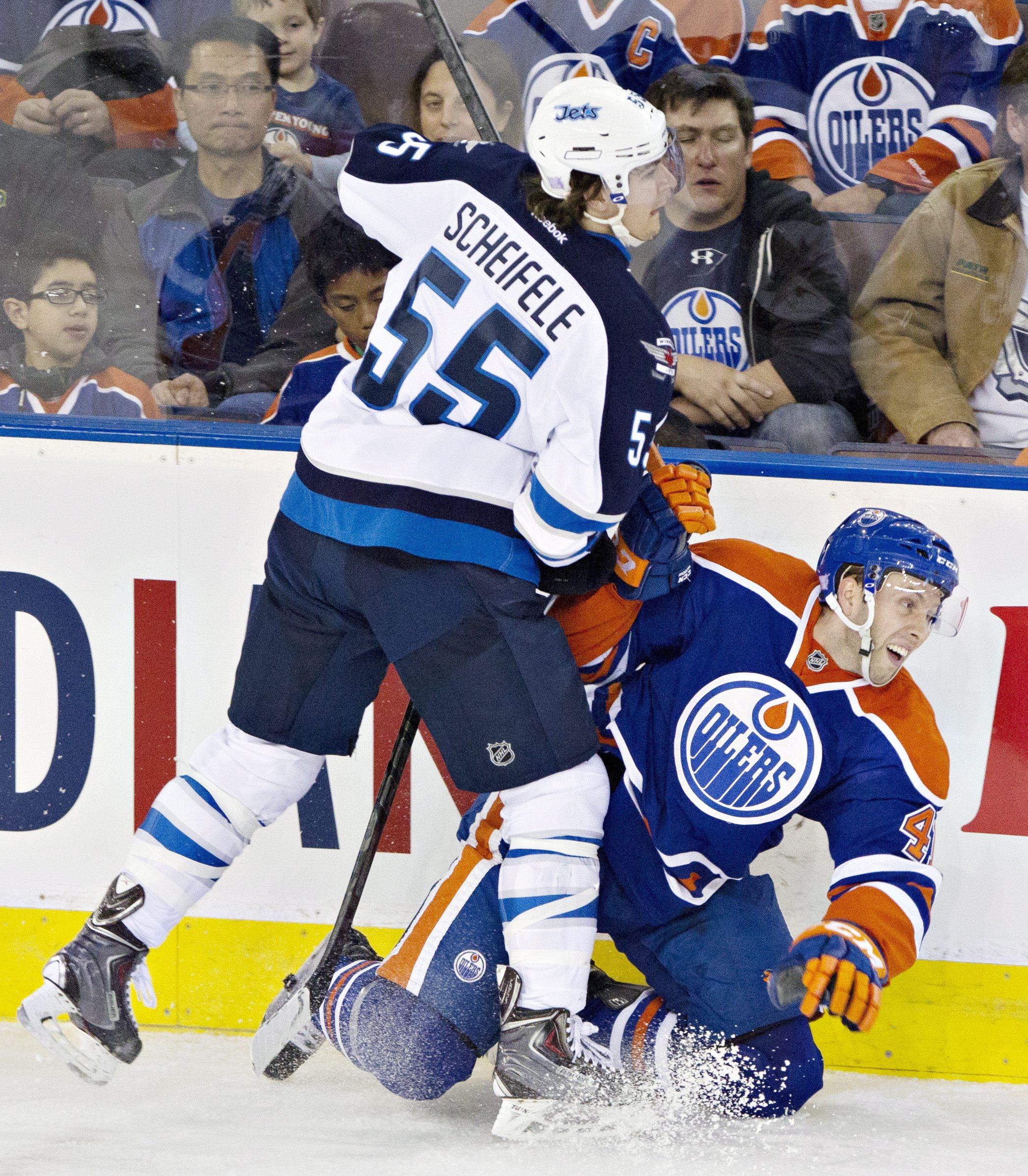 Frolik nets 2, Jets top Oilers in season opener
