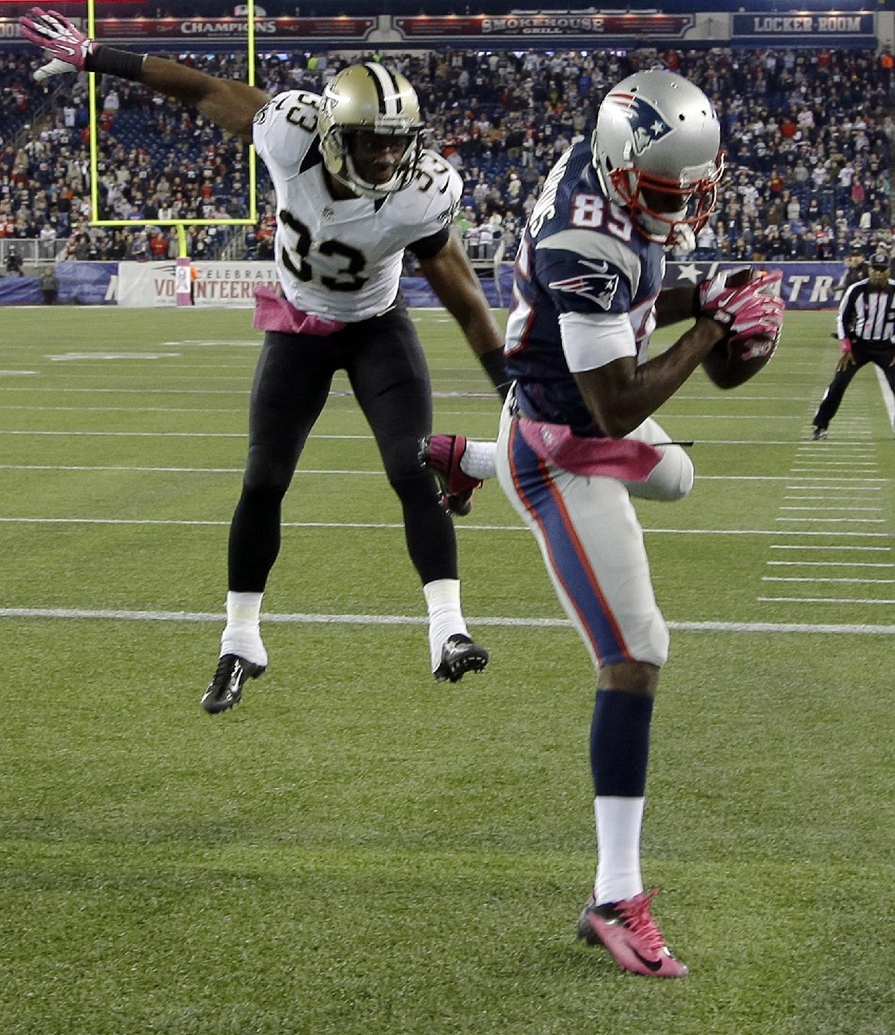 Kenbrell Thompkins comes down in the end zone with the winning TD to the chagrin of Jabari Greer. (AP)