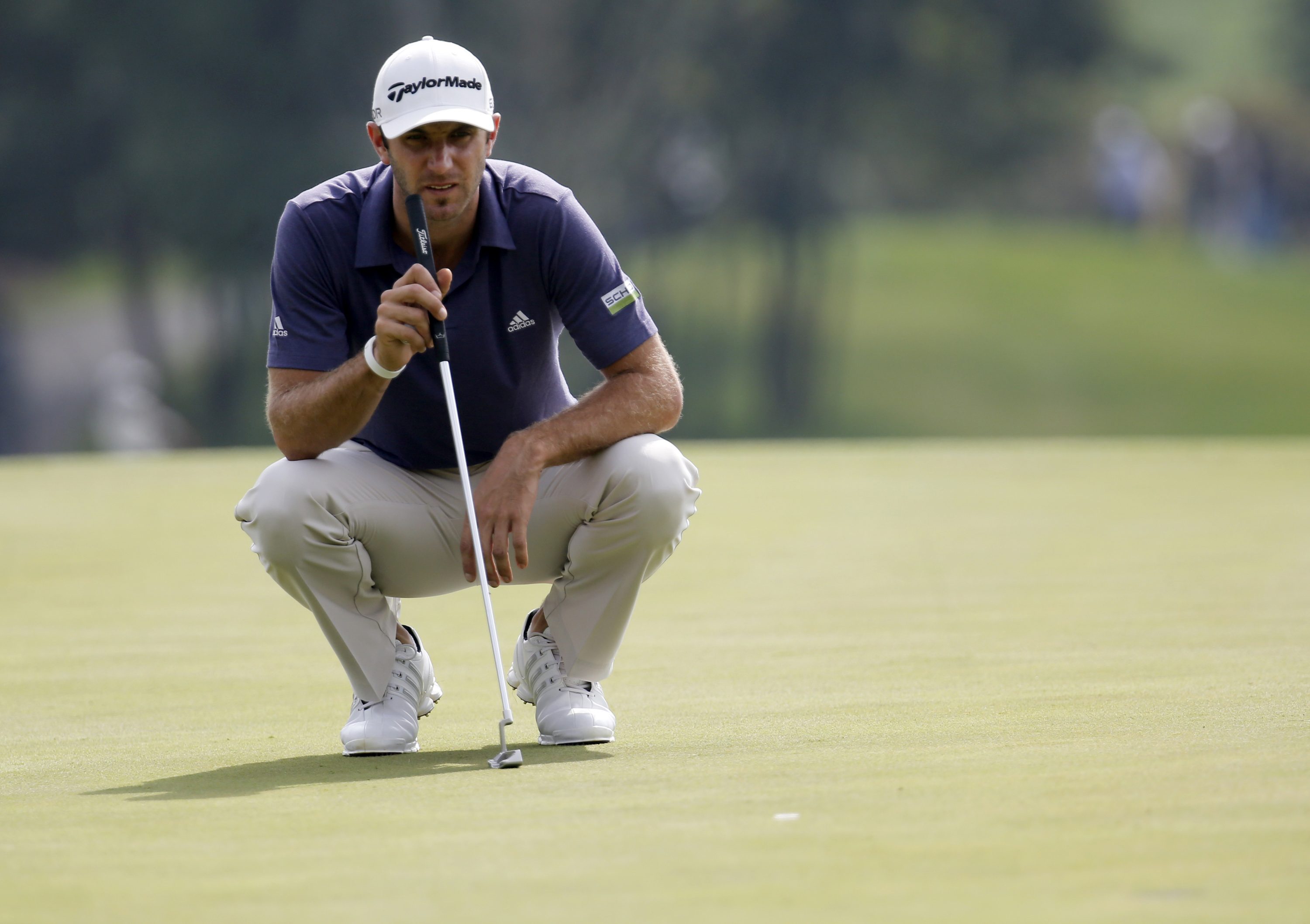Johnson ties course record and builds 5-shot lead
