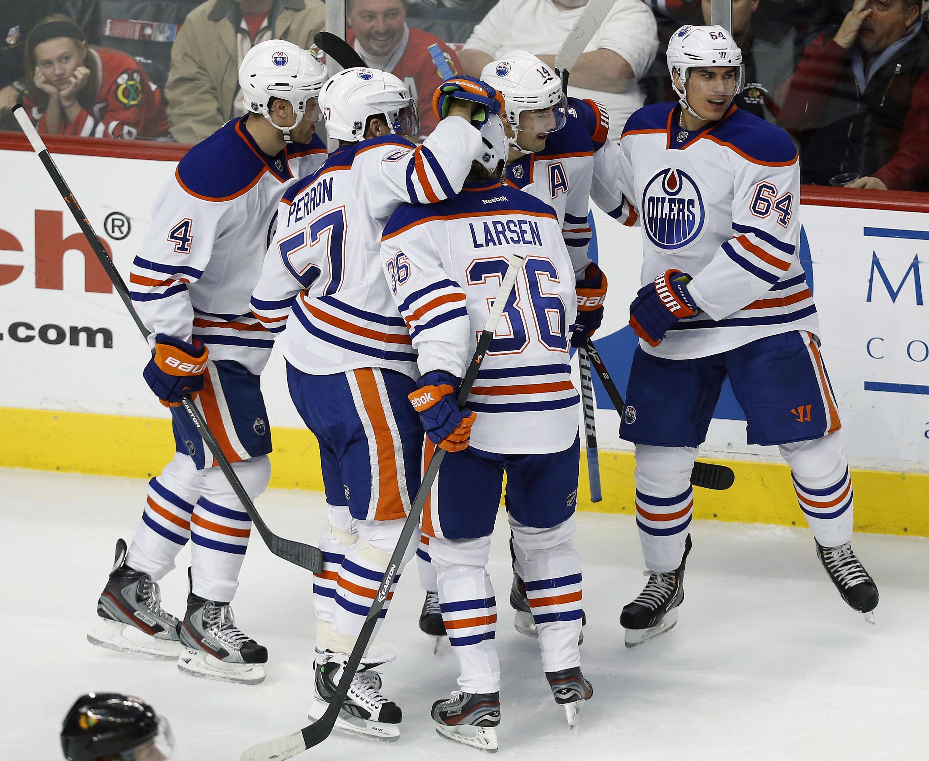Kruger's goal helps Blackhawks edge Oilers 5-4