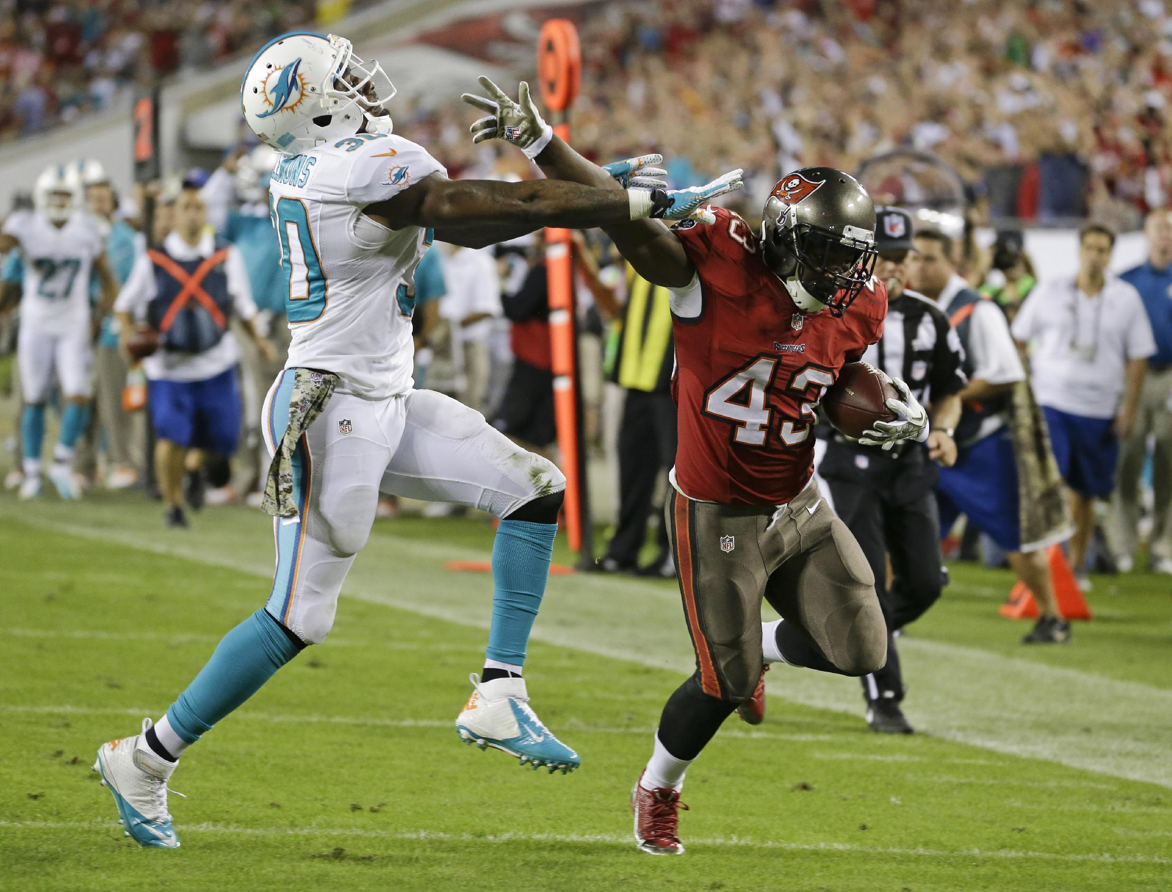 Scandal, latest loss have Dolphins fans fed up
