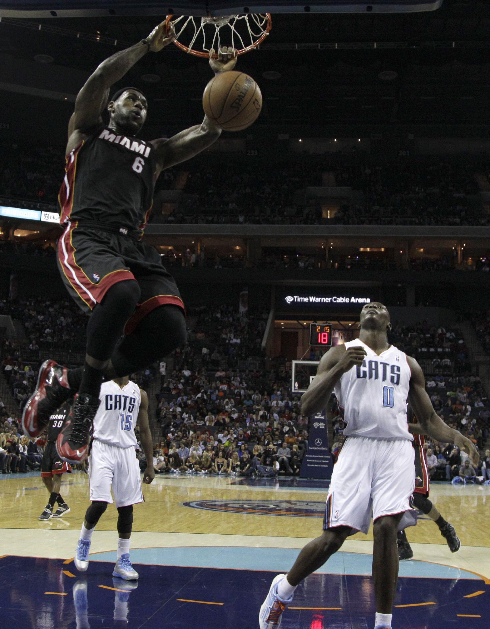 James scores 30 as Heat defeat Bobcats 97-81