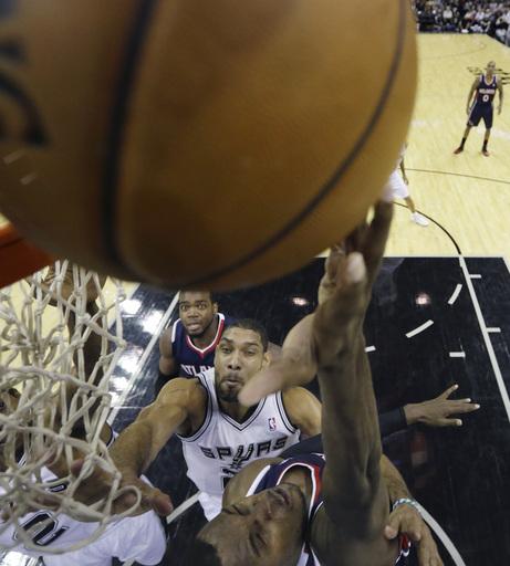 Duncan's jumper lifts Spurs over Hawks 102-100