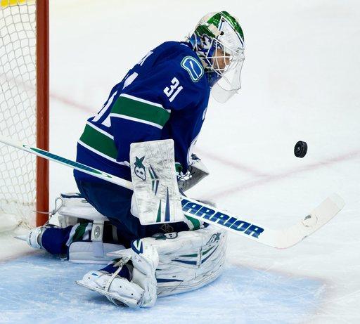 Canucks' Lack earns 1st NHL shutout, tops Canes