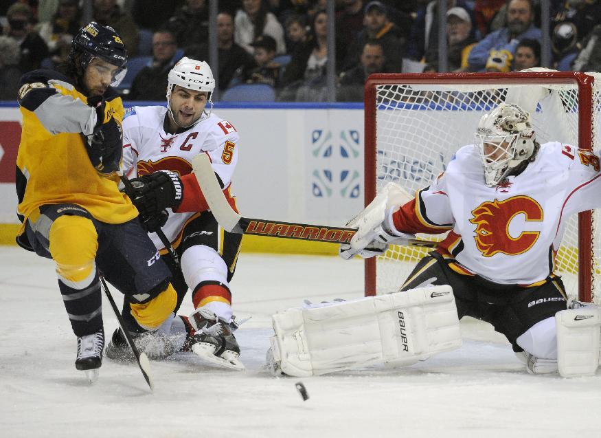 Stajan scores in OT, Flames beat Sabres 2-1