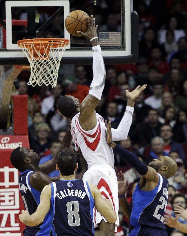 Nowitzki leads Mavs over Rockets 111-104