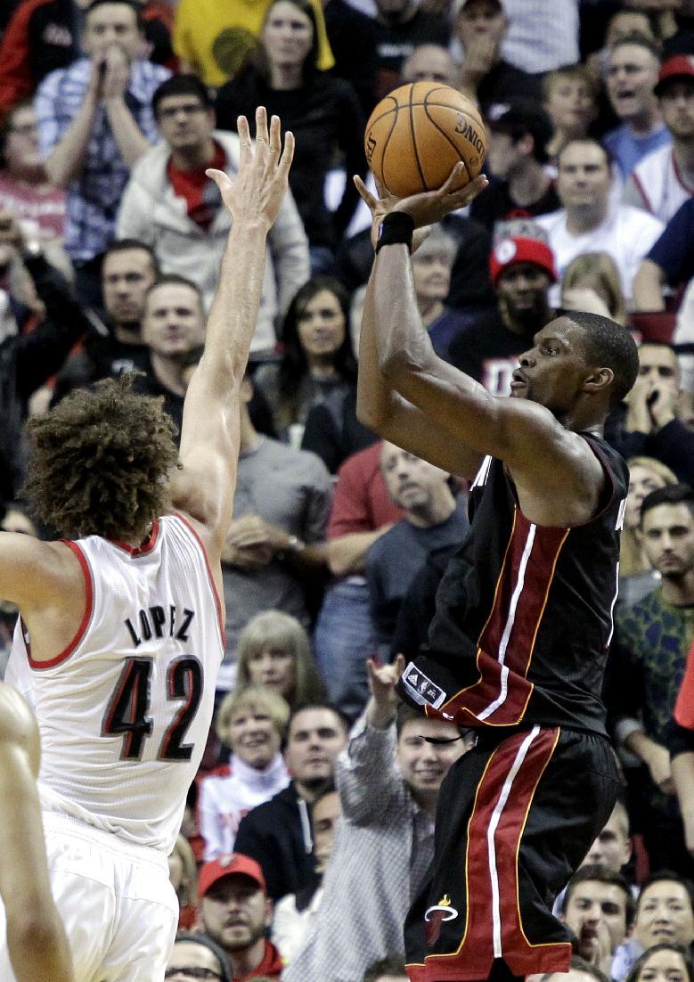 Bosh carries Heat, minus James, past Blazers