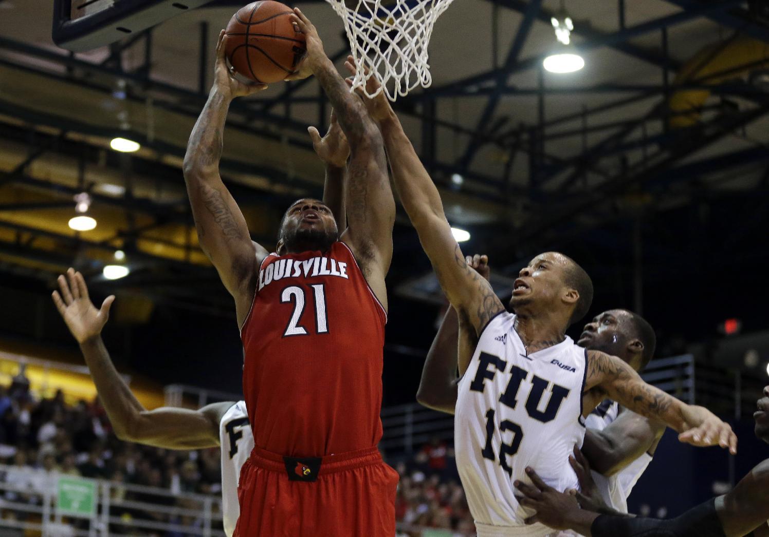 No. 14 Louisville dismisses F Behanan from team