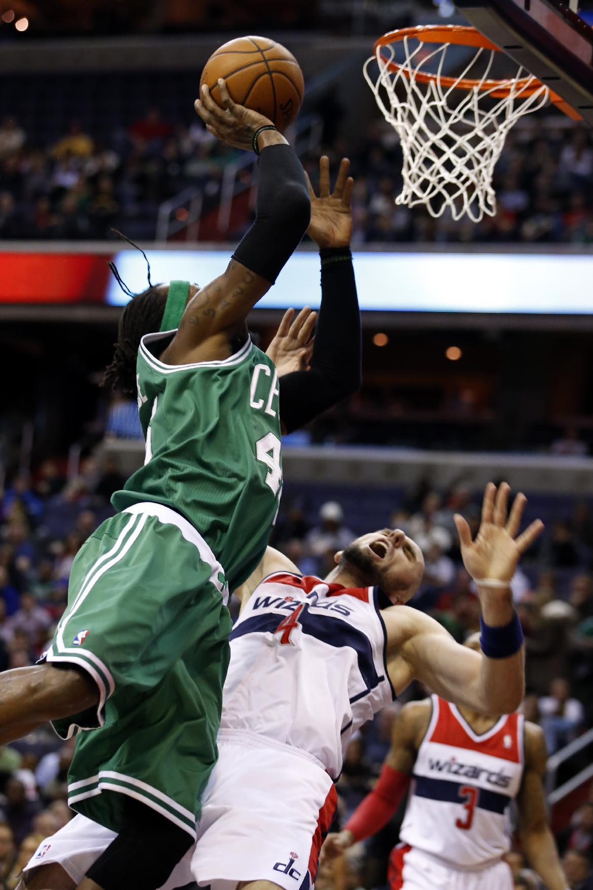 Undermanned Celtics beat Wizards 113-111 in OT