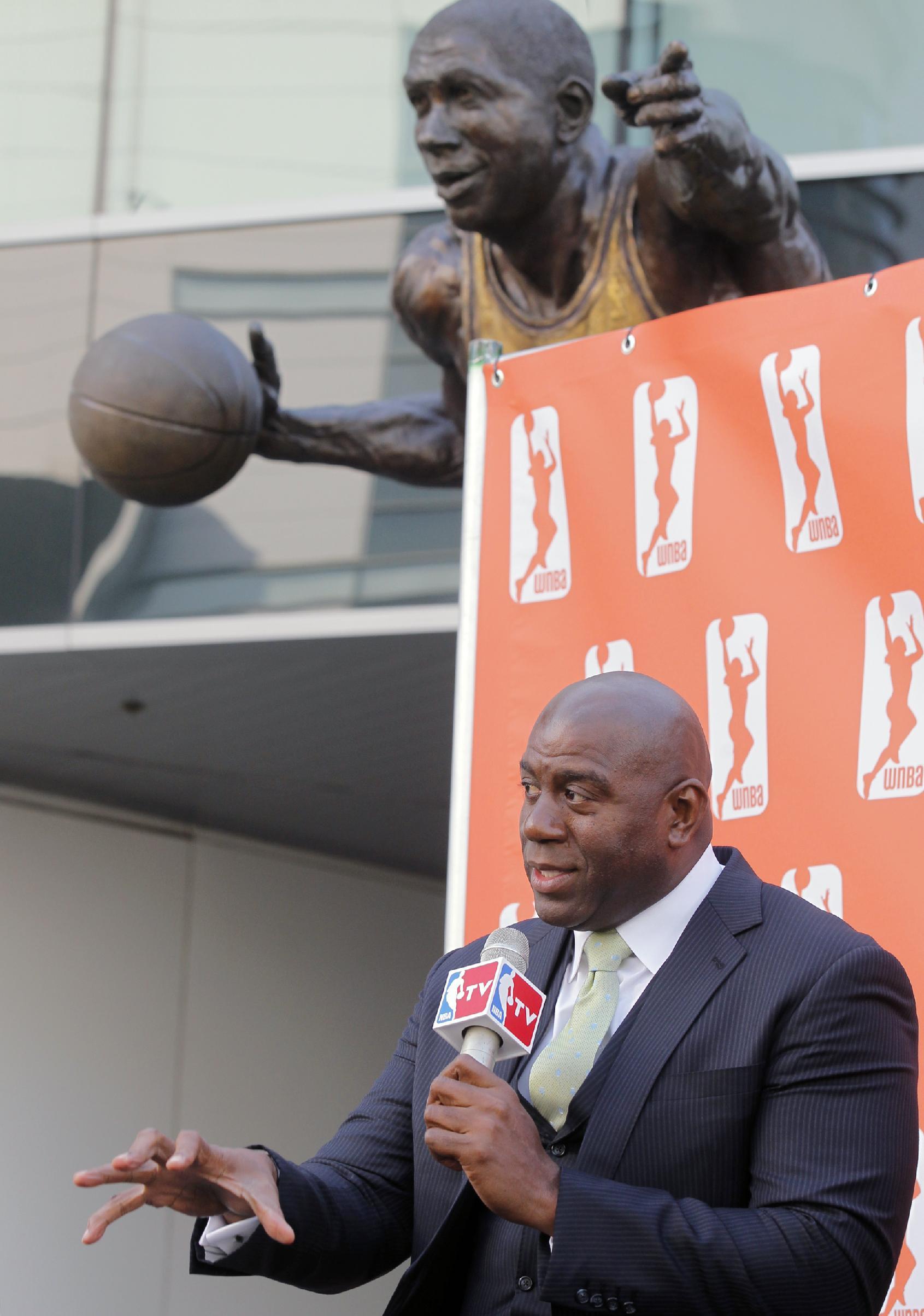 Magic Johnson buys Sparks, keeps WNBA team in LA