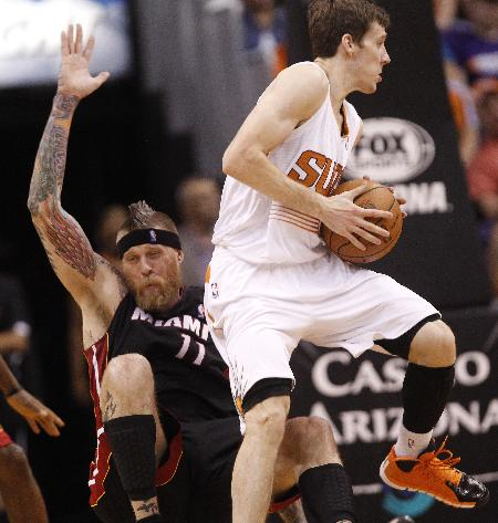 James scores 37 to lead Heat past Phoenix 103-97