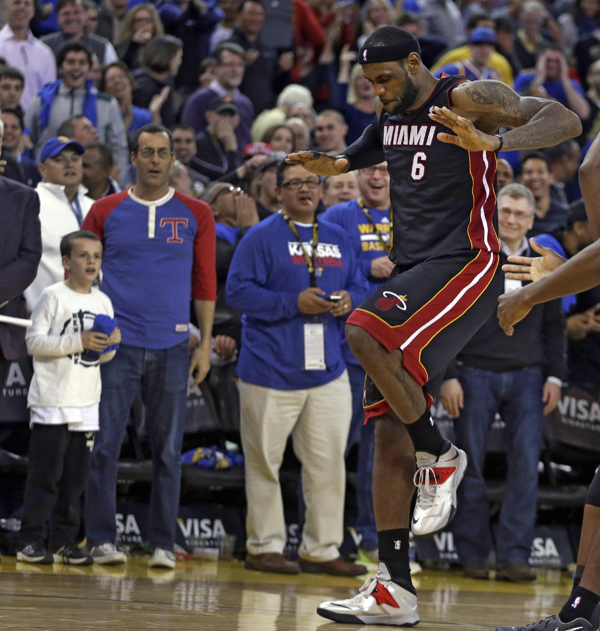 James' 3-pointer lifts Heat past Warriors, 111-110
