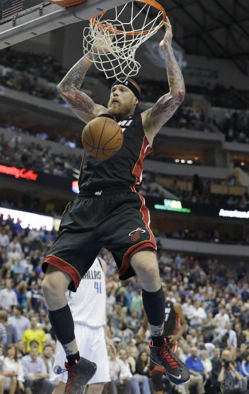 James scores 42, Heat pull away from Mavs 117-106