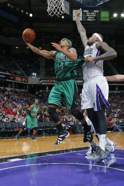 Kings hold off short-handed Celtics 105-98