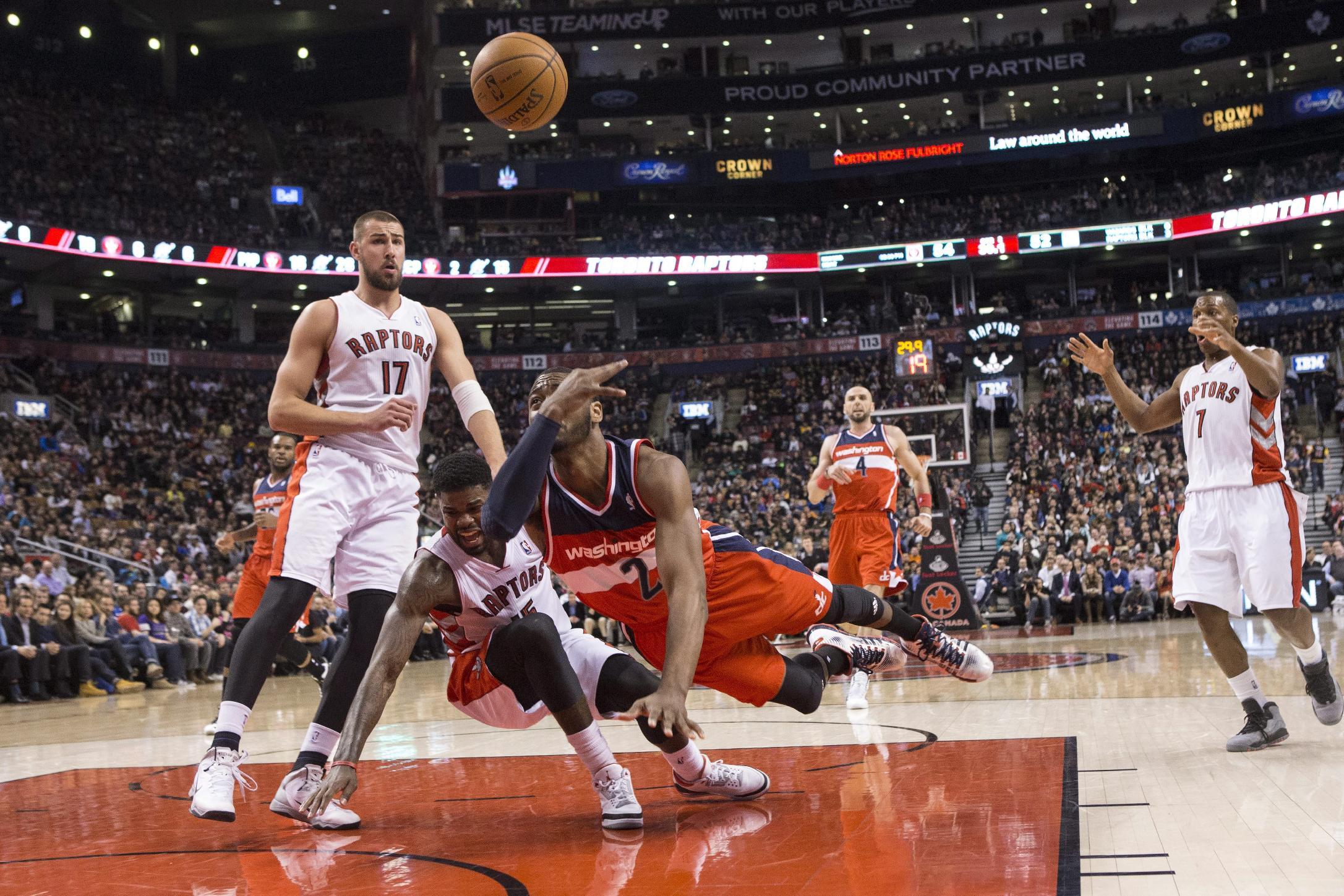 Wizards beat Raptors 134-129 in triple OT