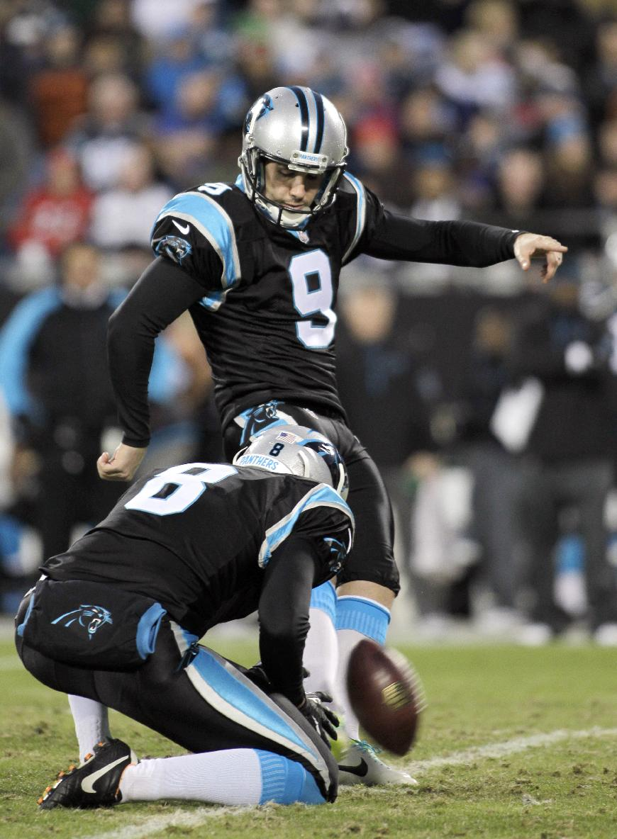 Panthers use tag to keep DE Hardy; re-sign K Gano