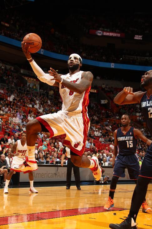 History! LeBron nets 61, Heat top Bobcats 124-107