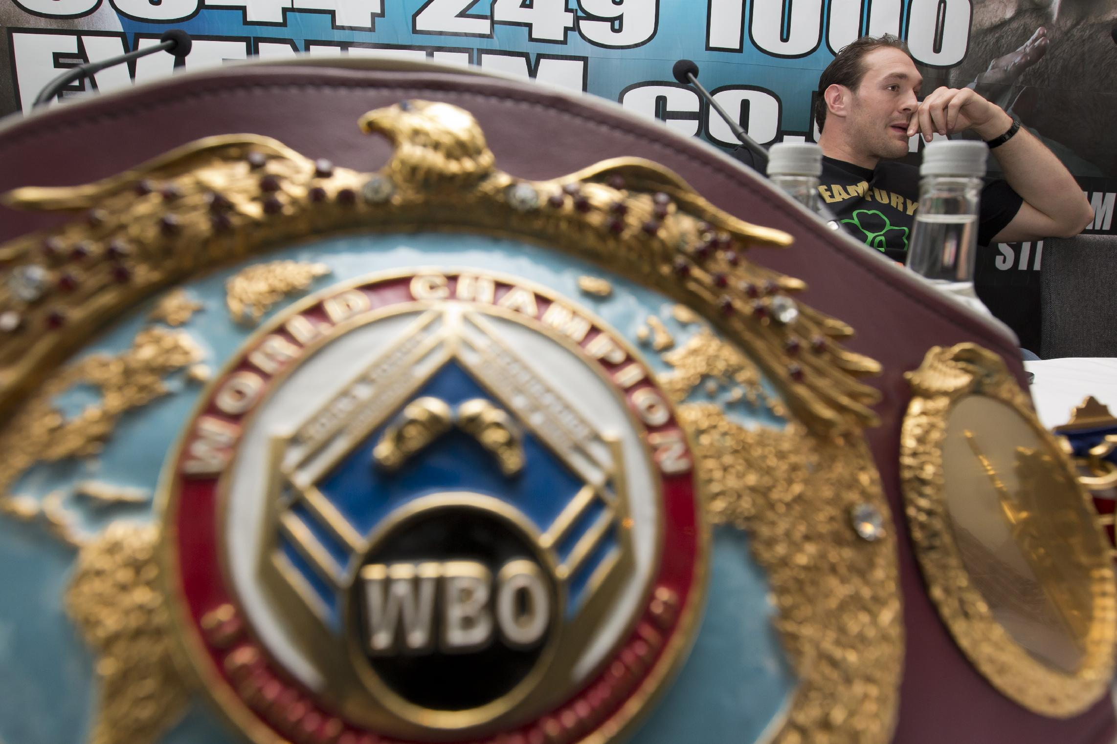 Boxer Tyson Fury lives up to name at media event