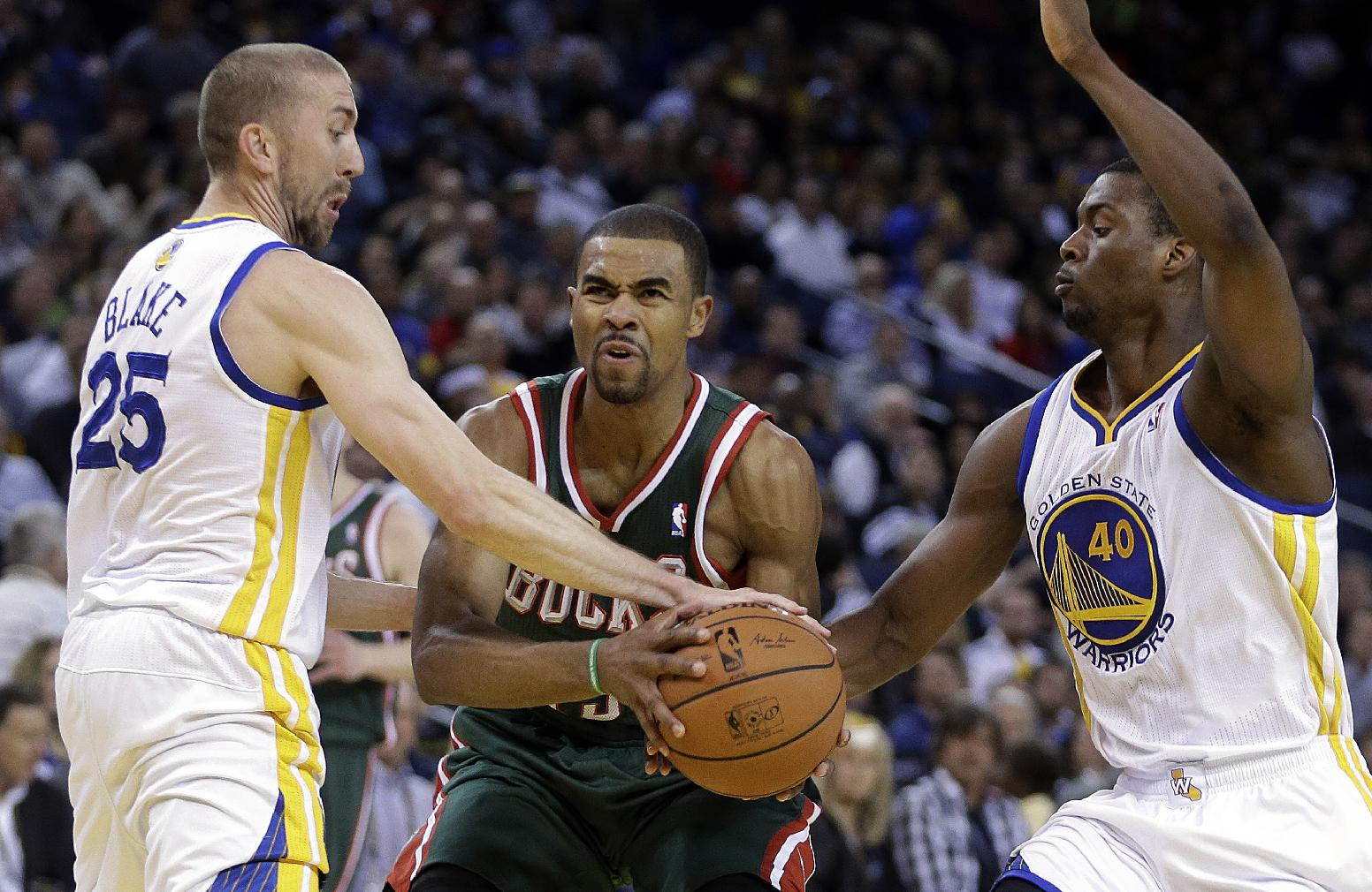 Warriors withstand scare to beat Bucks 115-110