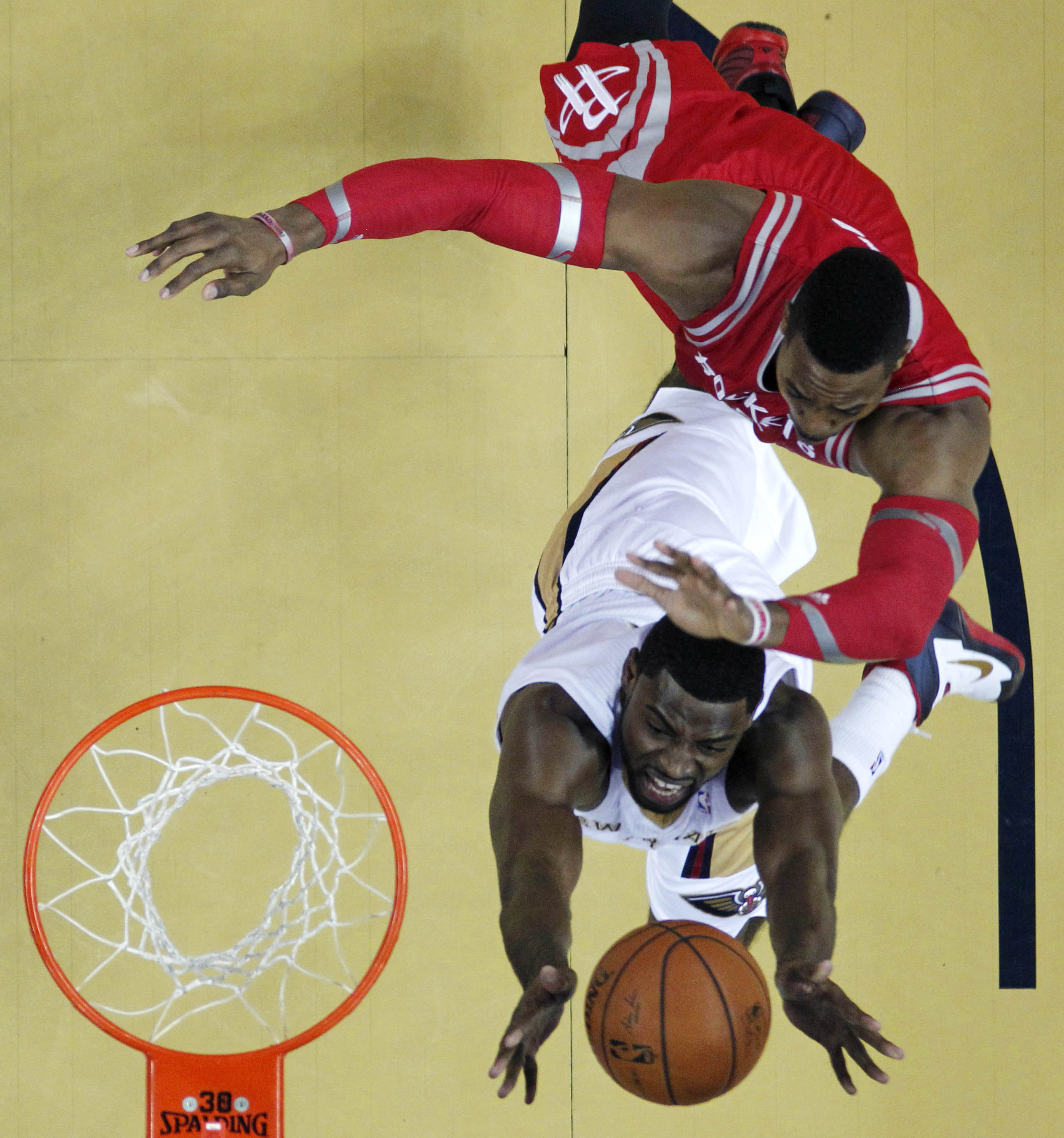 Evans leads Pelicans past Rockets, 105-100