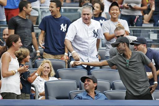 No joke! Chris Rock gets foul ball at Yankees game