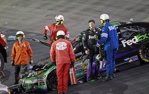 Spun by Harvick, Hamlin fires safety device at him