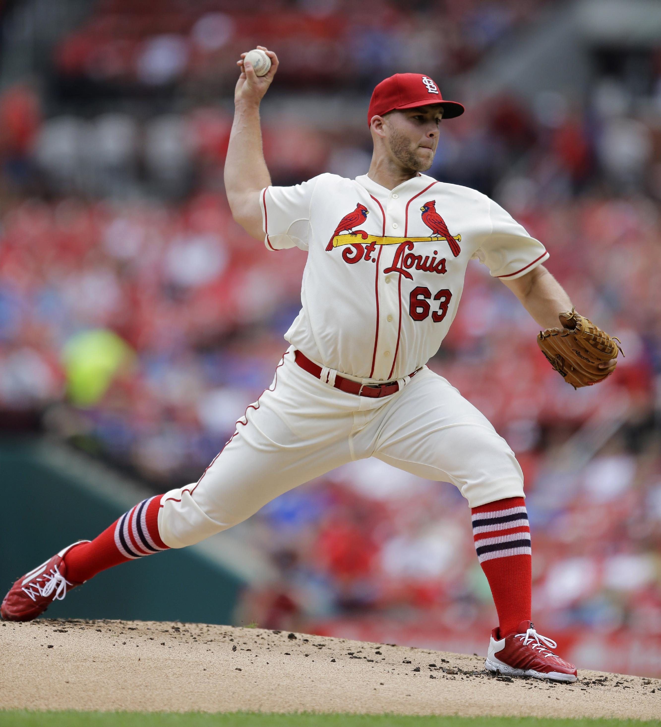 Cubs, Cardinals split doubleheader