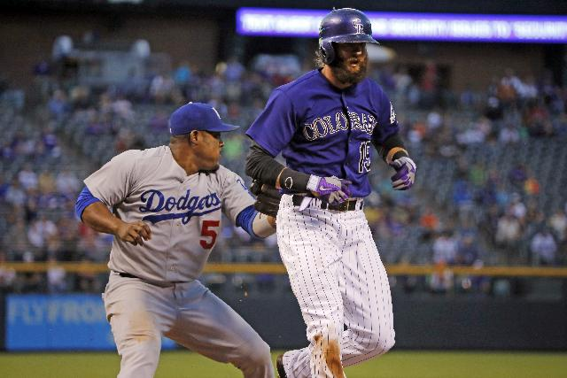 Dodgers ride 8-run inning to 11-3 win over Rockies