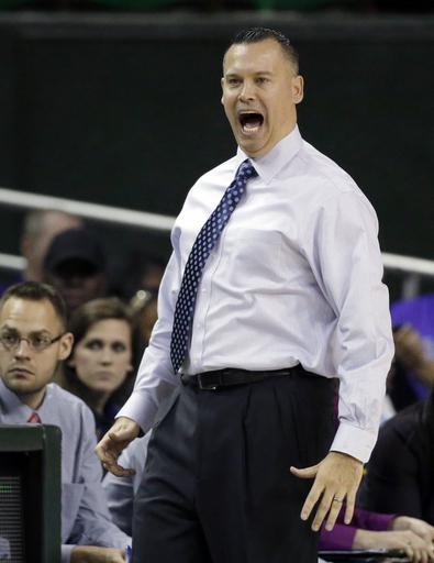 Kansas hires Schneider to coach women's basketball team
