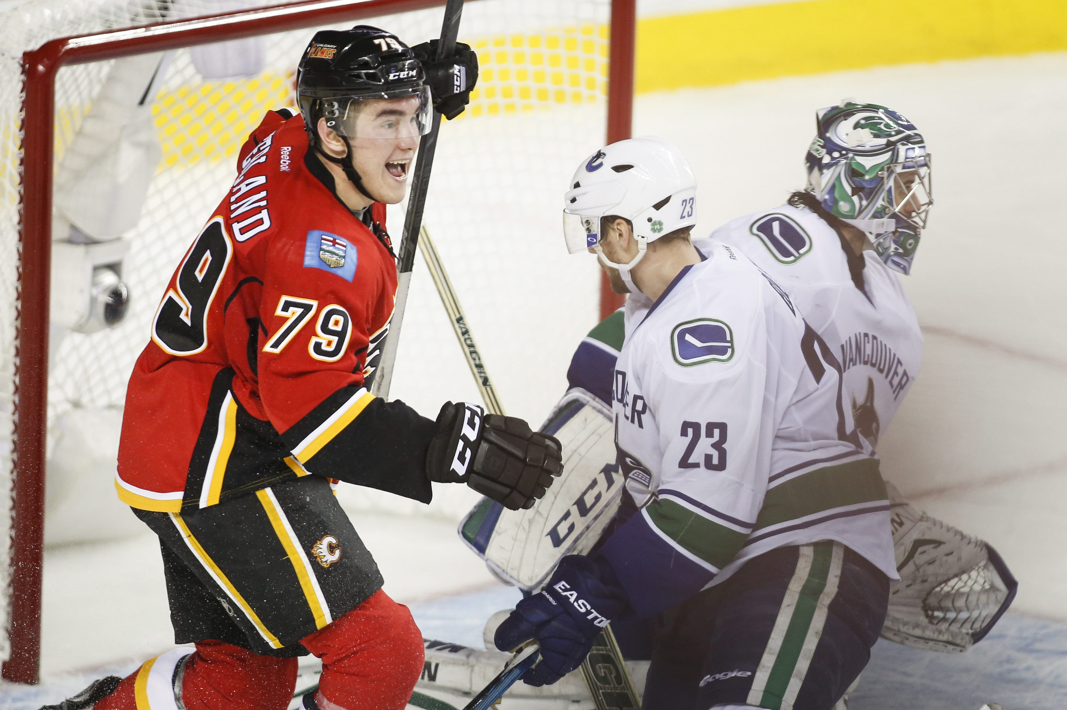 Flames beat Canucks 7-4 to advance in Stanley Cup playoffs