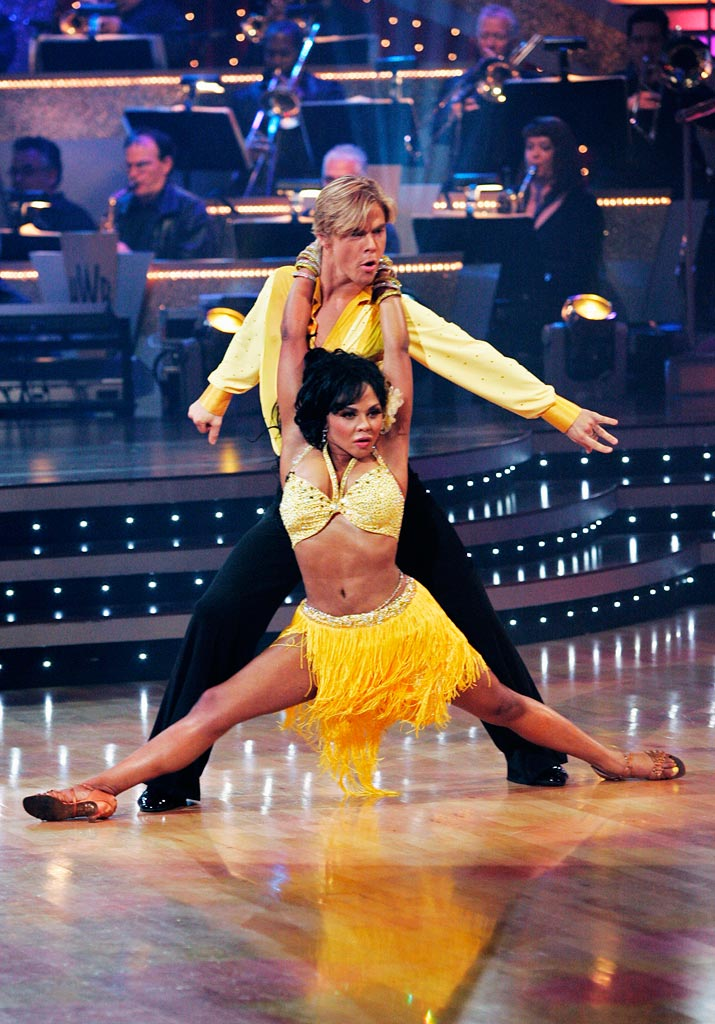 "Lil' Kim and Derek Hough perform the Samba to ""Remedio P'al Corazon"" by Alberto Plaza on ""Dancing with the Stars."""