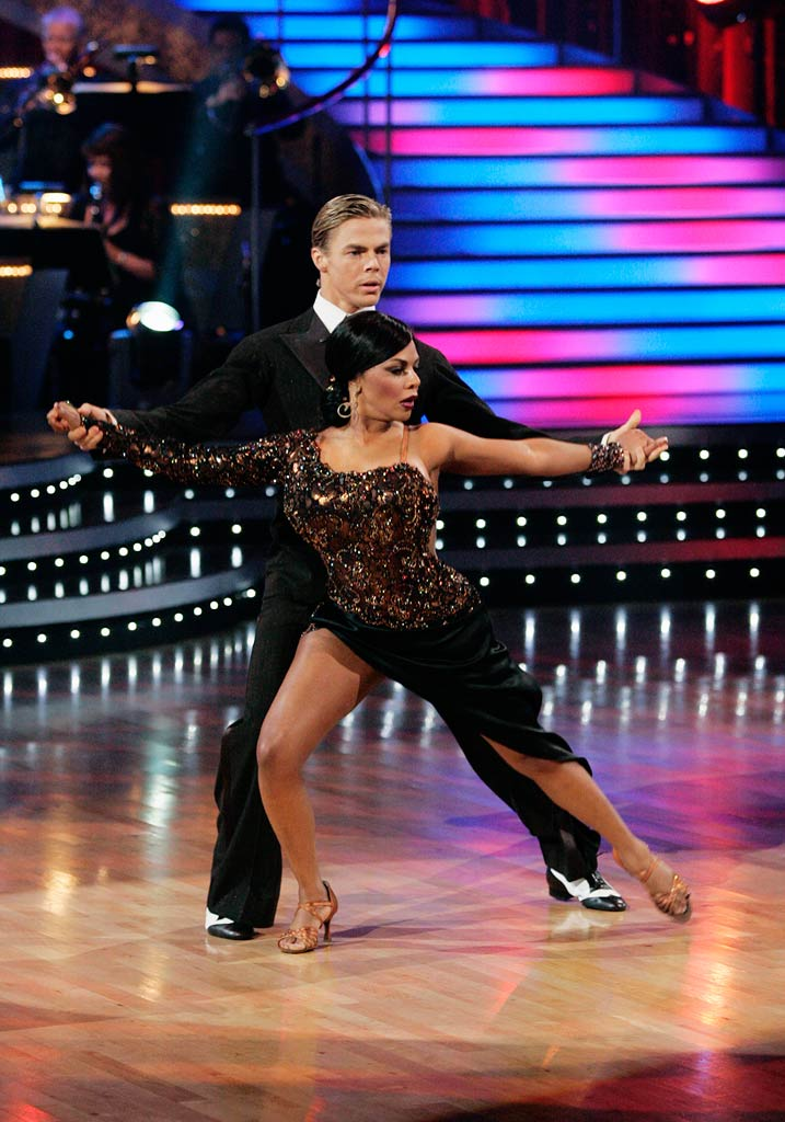 "Lil' Kim and Derek Hough perform the Argentine Tango to ""Taquito Militar"" by Conjunto Tipico Del Tango on ""Dancing with the Stars."""