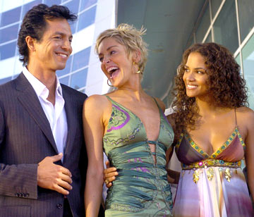 Premiere: Benjamin Bratt, Sharon Stone and Halle Berry at the Hollywood premiere of Warner Brothers' Catwoman - 7/19/2004