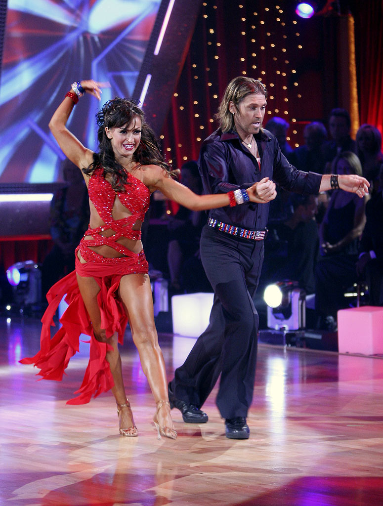 Billy Ray Cyrus and professional dancer, Karina Smirnoff perform a Latin dance in the 4th season of Dancing with the Stars.