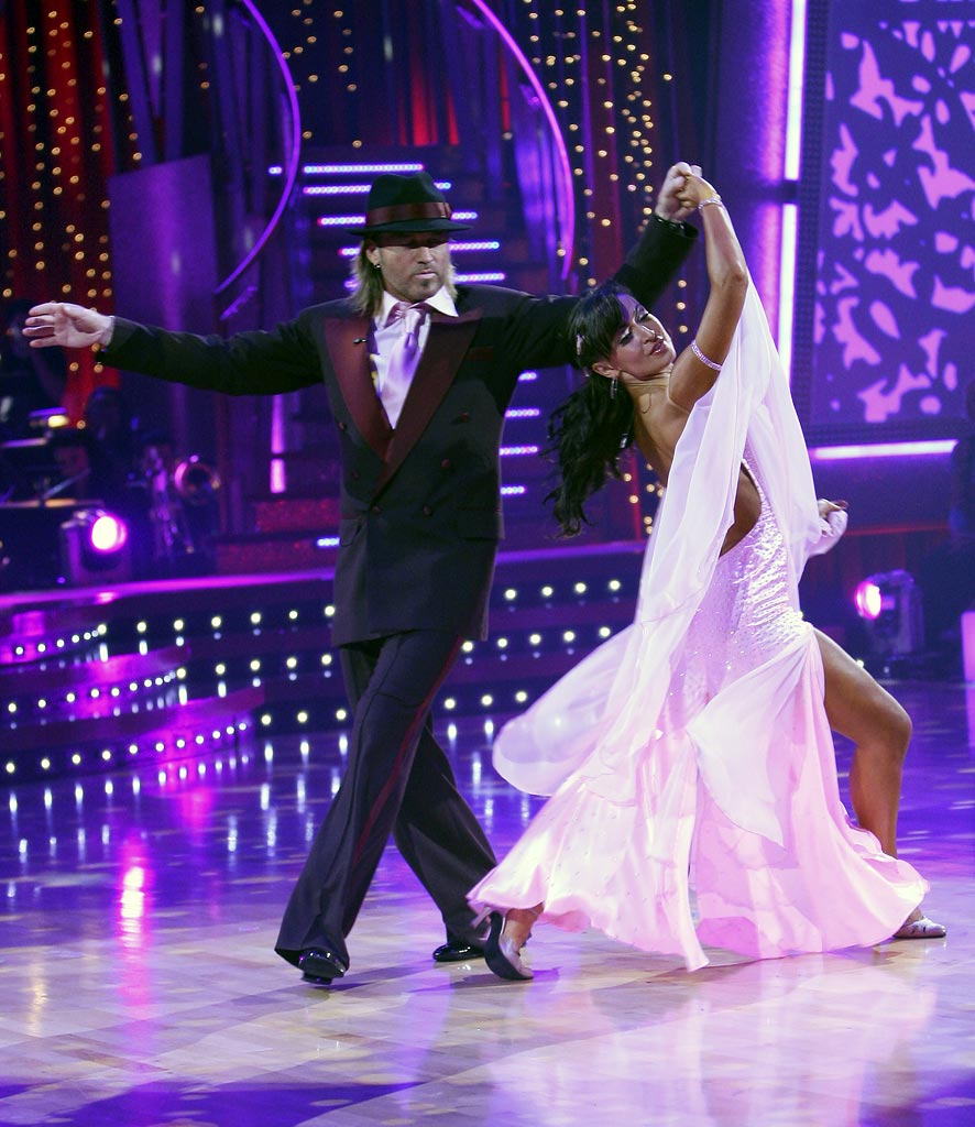 Billy Ray Cyrus and professional dancer, Karina Smirnoff perform a Ballroom dance in the 4th season of Dancing with the Stars.
