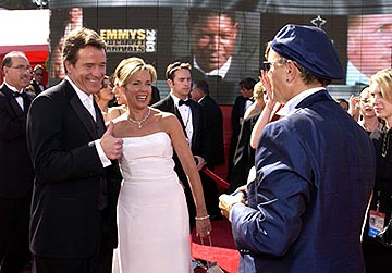 Bryan Cranston and his wife with Joe Pantoliano as Dennis Haysbertlooms large behind them 55th Annual Emmy Awards - 9/21/2003