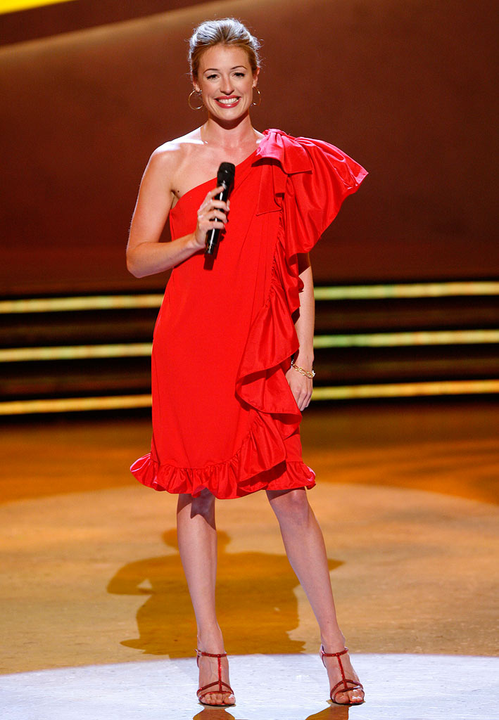 "On the Top 18 episode of Season 5 of ""So You Think You Can Dance,"" Cat Deeley wore a vintage one-shoulder, ruffle hem dress. She accessorized the bright red dress with a pair of equally crimson Gina sandals and TopShop hoop earrings."