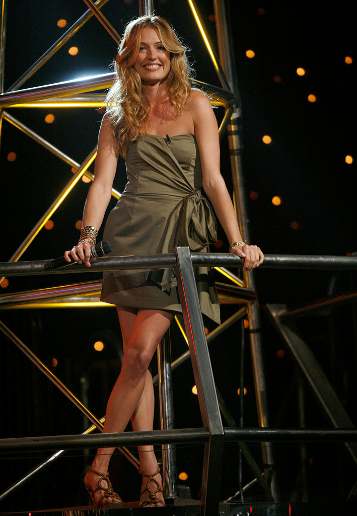 "During first results show of Season 5 of ""So You Think You Can Dance,"" Cat Deeley amped up a simple strapless dress from French Connection with Roberto Cavalli heels, Melinda Maria earrings, and stacked bangle bracelets."