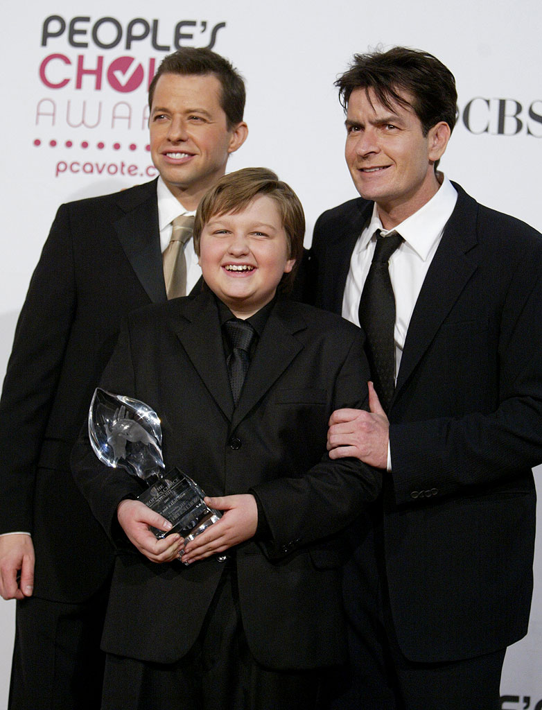 Jon Cryer, Angus T. Jones and Charlie Sheen of Two and a Half Men celebrate their win forFavorite TV Comedy at The 33rd Annual People's Choice Awards.