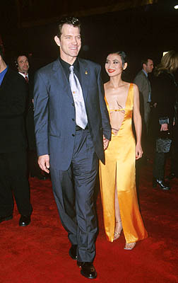 Premiere: Chris Isaak and Bai Ling at the Hollywood premiere of 20th Century Fox's Anna And The King - 12/15/99