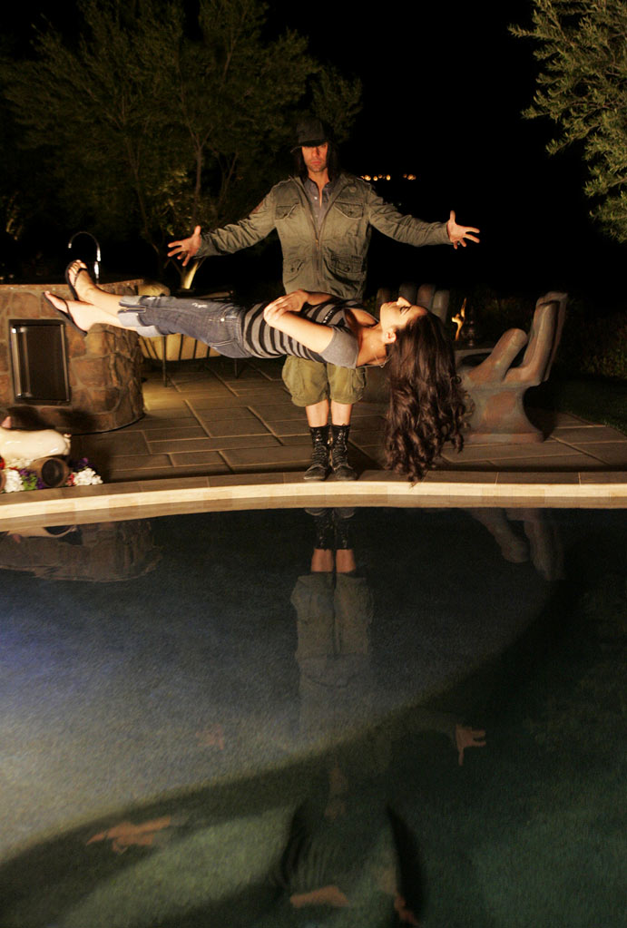 "Criss Angel levitates a woman during the filming of season six of ""Criss Angel Mindfreak."""