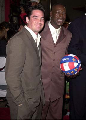 Premiere: Dean Cain with an esteemed member of the Harlem Globetrotters at the Mann's Chinese Theatre premiere of New Line's Little Nicky - 11/2/2000