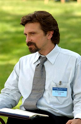 Dennis Boutsikaris as Dr. Lancaster Monk on USA Network